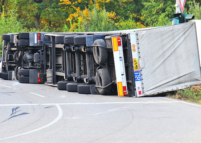 Who pays for damages after a truck accident?